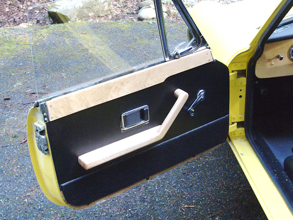 Custom door panels with birds-eye maple arm rests and caps. & Brian Laughlinu0027s 1969 MGB GT with GM 3.4L 60-degree V6