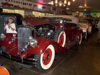 Mary Schils inspects a Rolls Royce in Frank Kleptz's collection