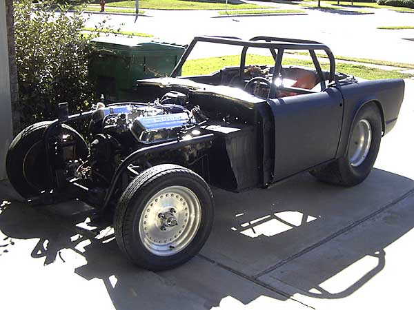jason norman's 1967 triumph tr4, with 427 cubic inch chevy v8